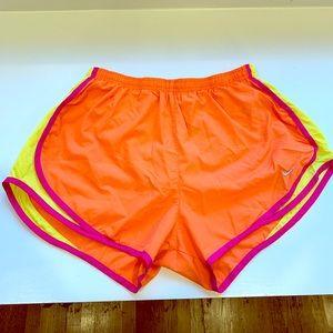 Orange, pink and yellow Nike running short